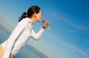 the importance of hydration; woman drinking water
